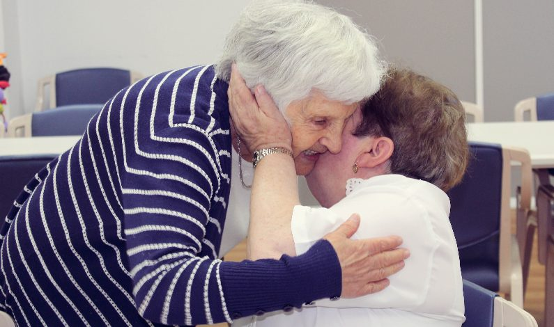 elderly lady embraced support