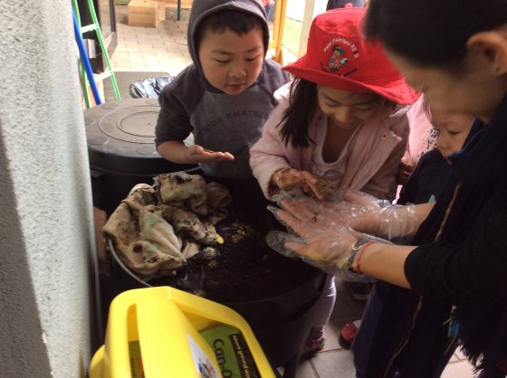 Preschoolers learning about composting